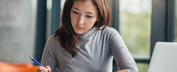 woman studying for act